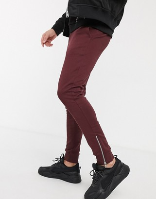 ASOS DESIGN organic super skinny sweatpants in burgundy with silver zip cuffs