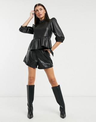 Vero Moda peplum leather look top with button back detail in black