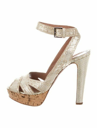 Alaia Embossed Leather Pumps Gold