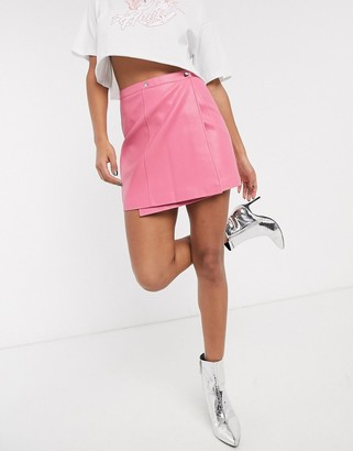Asos DESIGN wrap A line leather look mini skirt with snap buttons