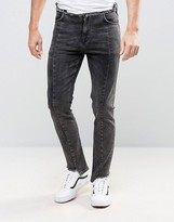 Asos Skinny Jeans With Stepped Hem And Raw Waistband In Washed Black