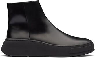 Prada Zipped Wedge Sole Boots