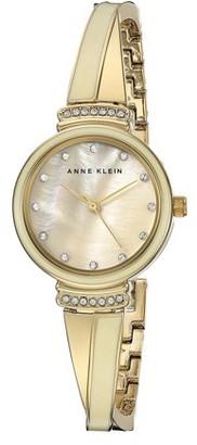 Anne Klein Women's 2216IVGB MOP Dial Beige and Yellow Steel Bangle Bracelet Swarovski Crystal Watch