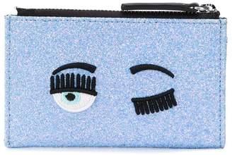 Chiara Ferragni flirting eye glittery wallet