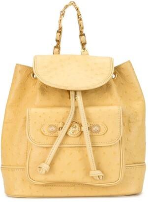 Versace Pre Owned 1990s Sunburst charm backpack
