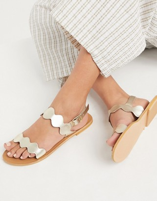 ASOS DESIGN Feedback leather flat sandals in gold