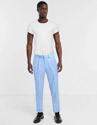 ASOS DESIGN tapered smart trousers in blue with turn up