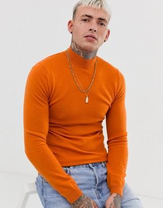 ASOS DESIGN muscle fit merino wool turtle neck jumper in orange