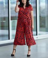 Glam Navy & Orange Floral Tie-Waist Surplice Jumpsuit - Plus