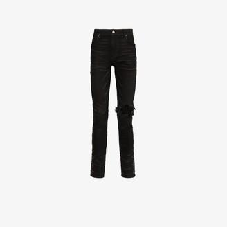 Amiri Broken side studded skinny jeans