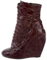 Alaia Embossed Wedge Boots