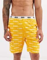Asos Design ASOS DESIGN lounge pyjama shorts in orange with tired print-Multi