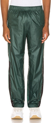 Acne Studios Pegasus Trousers in Forest Green | FWRD