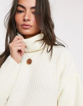 ASOS DESIGN fluffy jumper with cowl neck