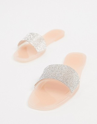 Truffle Collection embellished jelly sliders in clear beige