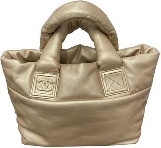 Chanel Coco Cocoon Gold Leather Handbags