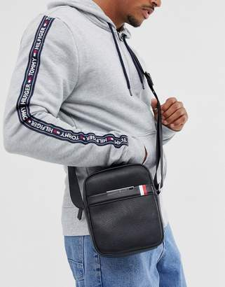 Tommy Hilfiger faux leather flight bag in black with flag logo