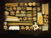 Art.com Many Different Types of Pasta on Dark Wooden Background Photographic Print By Walter Cimbal - 30x41 cm