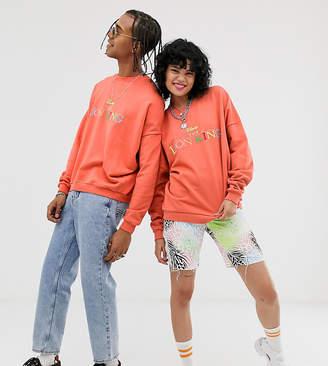 Asos Design Disney The Lion King x DESIGN unisex oversized sweatshirt with logo embroidery-Orange