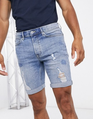 Topman skinny denim shorts with rips in bleached blue