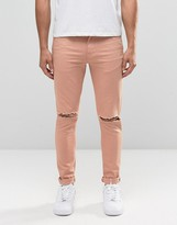 Asos Super Skinny Jeans With Knee Rips In Pink