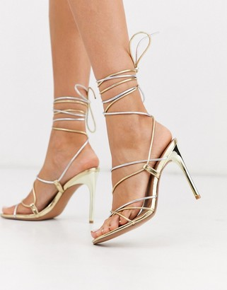 Asos Design DESIGN Non Stop strappy tie leg heeled sandals in gold and silver metallic