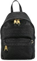 Moschino logo embossed backpack - women - Leather - One Size