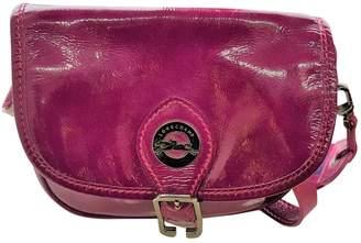 Longchamp Purple Patent leather Handbags