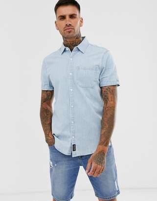 Hollister icon logo pocket short sleeve slim fit denim shirt in mid wash-Blue