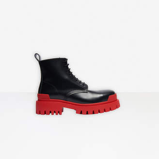 Balenciaga Strike 20mm Bootie in black matte smooth leather and red sole