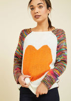 Racking your brain for a picture of the perfect sweater? Give your noggin a rest! The arrival of this heart-printed pullover - with its orange intarsia graphic and rainbow motif on its raglan sleeves and back - puts your ideal ensemble right before your e