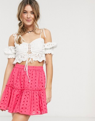 Asos DESIGN tiered broderie mini skirt in pink
