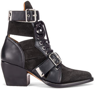 Chloé Lace Up Buckle Boots in Charcoal Black | FWRD