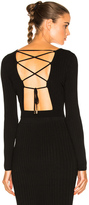 Cushnie et Ochs Long Sleeve Lace Up Back Crop Top in Black.