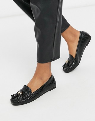 Truffle Collection flat tassel loafers in black croc