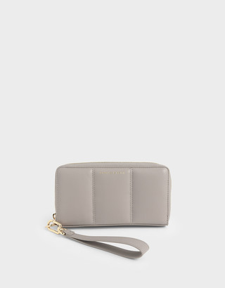 Charles & Keith Mini Zip Around Quilted Tassel Wallet