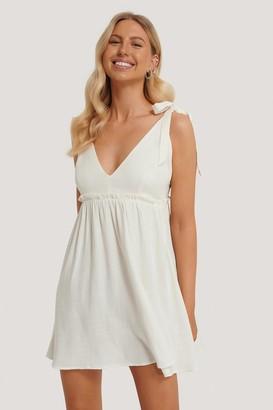 Stéphanie Durant X NA-KD Deep V-Neck Straps Mini Dress