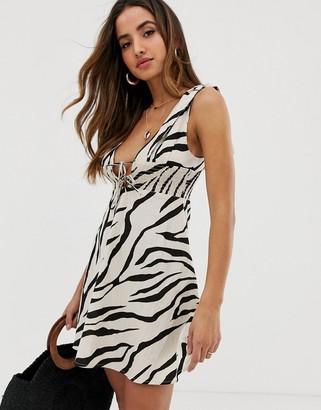 Asos Design DESIGN tie shoulder plunge mini sundress with shirred waist in zebra print