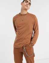 Asos Design DESIGN relaxed long sleeve raglan t-shirt with high neck in brown