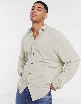 ASOS DESIGN oversized fit button collar shirt in viscose in stone