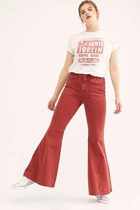 We The Free Crvy Utility Flare Jeans by at Free People Denim