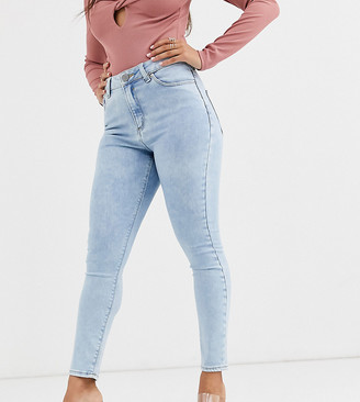 Asos DESIGN Petite Ridley high waisted skinny jeans in light stonewash blue