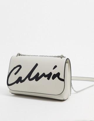 Calvin Klein cross body bag with script logo in stone