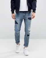 Asos Skinny Jeans With Rip And Repair Detail In Mid Blue