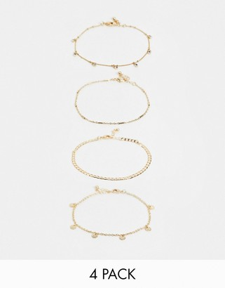ASOS DESIGN pack of 4 anklets with fine curb chain and crystal disc charms in gold tone