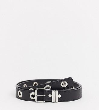 Asos DESIGN Curve eyelet jeans waist and hip belt in black