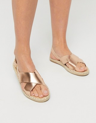 Truffle Collection cross strap espadrille sandals in gold