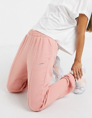 Nike mini metallic swoosh oversized joggers in coral