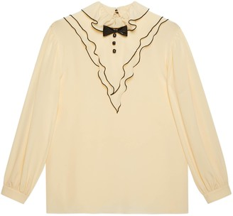 Gucci Ruffled silk shirt with bow brooch