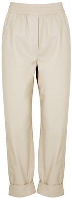 Nanushka Selah ecru faux leather trousers